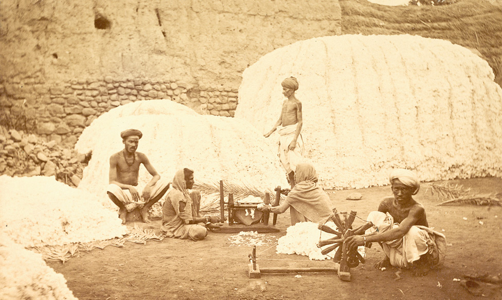 Cotton stacks and 'churka' or cotton gin in operation, Berar